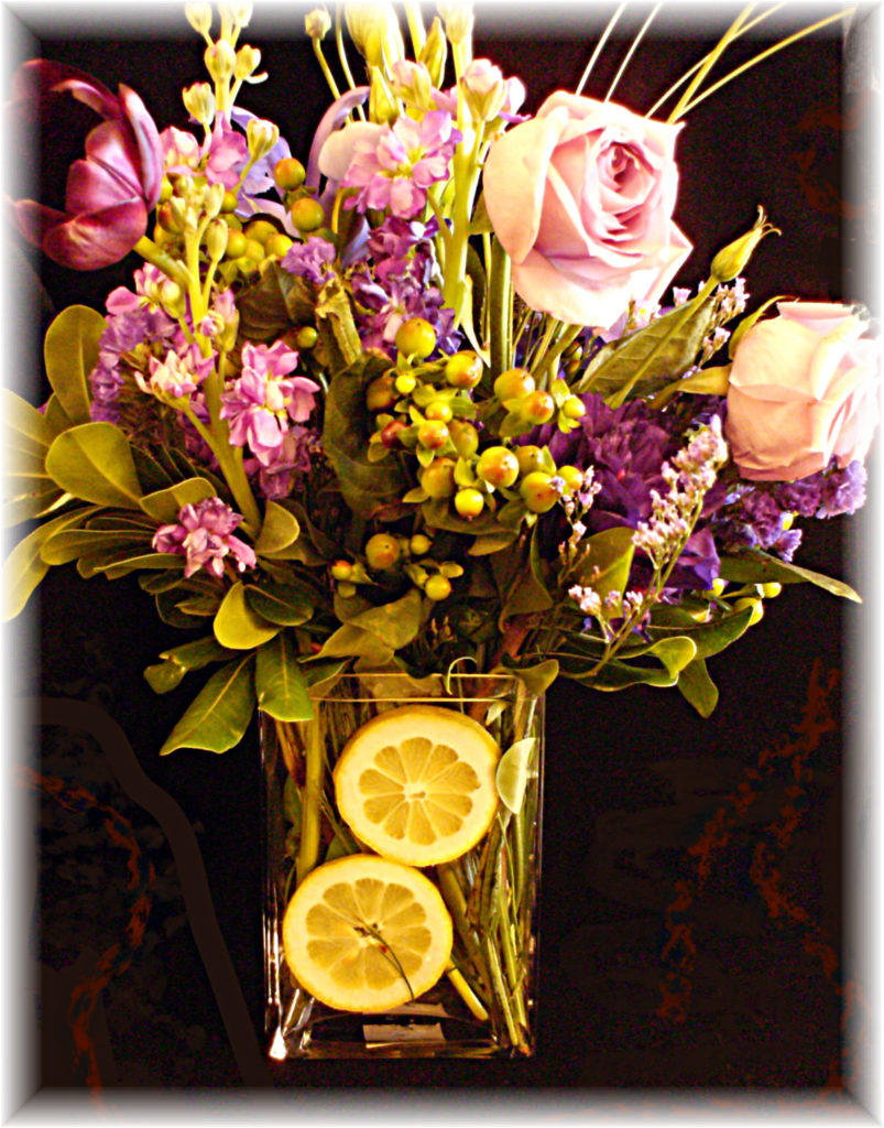 Lemons disguise stems in a glass vase